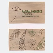 Business card on craft paper with branches and plants