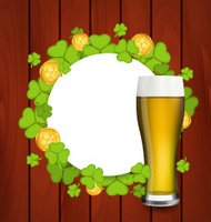 Greeting card with glass beer, shamrocks and golden coins