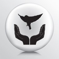 Round Icon With Two Hands Cupping a Flying Bird Silhouette