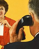 Man on the Telephone and a Woman Watching