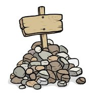 rock stack and wooden placard