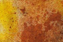 Splattered brown and yellow ink background