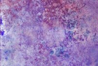Ink splatter on paper with shades of lavender