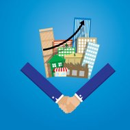 business man shake hand with group of real estate building