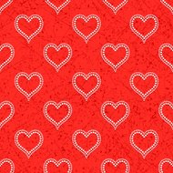 Seamless with polka dotted hearts