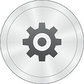 Gear icon on a round button.