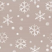 Snowflakes falling down on cardboard background. Winter themed seamless pattern