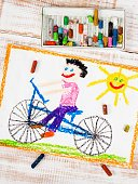 colorful drawing: boy riding bike