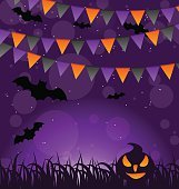 Halloween background with pumpkins and hanging flags