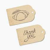 Craft paper tags with THANK YOU hand lettering and sketched