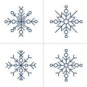 Set of four different simple snowflake icons on white background