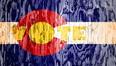vote text on colorado state flag backdrop