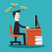 Successful happy businessman working in office at computer