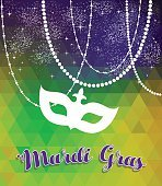 Mardi gras green and purple background with mask
