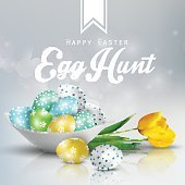 Easter background with colored eggs on a plate