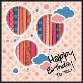 Birthday card in the style of cutouts with balloons and