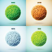 Four seasons collage. Spring, Summer, Autumn, Winter. Grass circle shape.