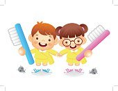Boy and girl is holding a big toothbrush. Education