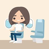 Cute brunette girl sitting in the aircraft
