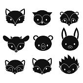 Set of cartoon woodland animals heads. Vector silhouettes isolated on