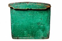 Green painted lid of an antique wooden chest.