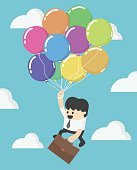 Businessman fly up away high on balloon. Young successful busine