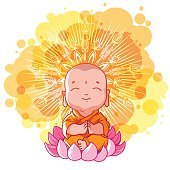 Little meditating monk on the lotus. Sunny day.