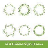 Set of six hand drawn circle floral frames.